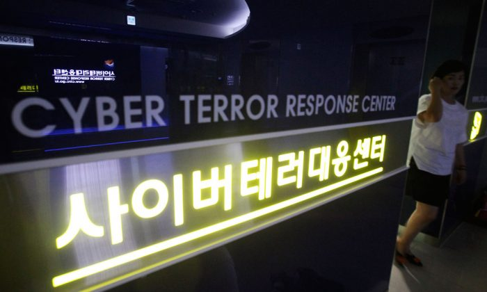 A woman walks by a sign at Cyber Terror Response Center of National Police Agency in Seoul, South Korea, on July 16, 2013. Most North Koreans have never even seen the Internet. But the country Washington suspects is behind a devastating hack on Sony Pictures Entertainment has managed to orchestrate a string of crippling cyber infiltrations of South Korean computer systems in recent years, officials in Seoul believe, despite North Korea protesting innocence. (AP Photo/Ahn Young-joon)