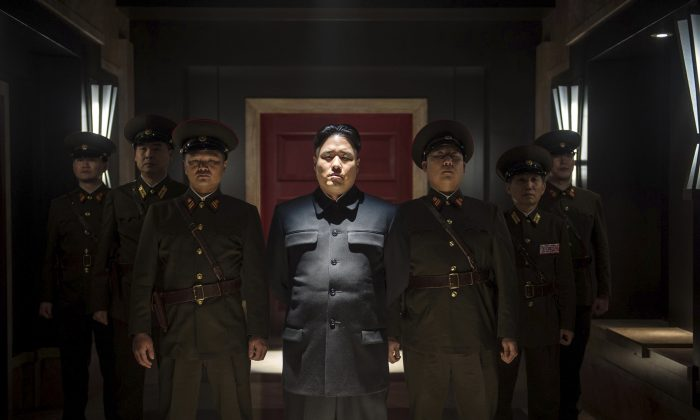 "In this undated photo provided by Columbia Pictures - Sony, Actor Randall Park, center, portrays North Korean leader Kim Jong Un in Columbia Pictures' ""The Interview."" If the U.S. government's claim that North Korea was involved in the unprecedented hack attack on Sony Pictures that scuttled Seth Rogen's latest comedy is correct, no one can say they weren't warned. The movie, ""The Interview,"" pushed all of North Korea's buttons. (AP Photo/Columbia Pictures - Sony, Ed Araquel)"