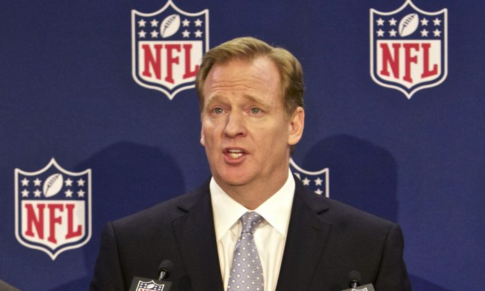 FILE - In this Dec. 10, 2014, file photo, NFL commissioner Roger Goodell speaks at an NFL press conference announcing new measures for the league's personal conduct policy during an owners meeting in Irving, Texas. Nearly 500 employees at NFL headquarters in New York turned over phone and email records to investigators looking into how Commissioner Roger Goodell and his staff pursued and handled evidence in the Ray Rice case, two people familiar with the situation told The Associated Press on Tuesday, Dec. 16, 2014. The people spoke to the AP on condition of anonymity because details of the investigation won't be made public until former FBI director Robert S. Mueller III releases his report. (AP Photo/Brandon Wade, File)