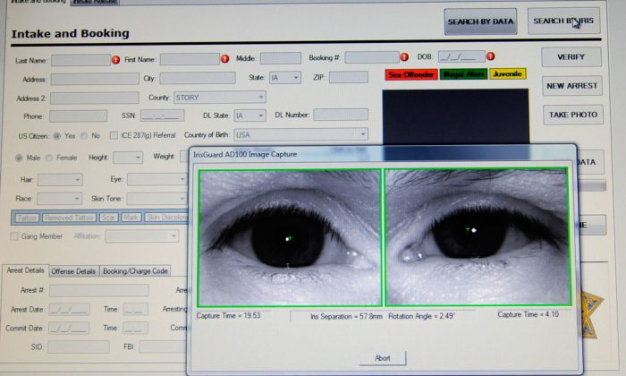 Scans of an inmate's eyes appear on a computer monitor attached to an identification system scanner on Feb. 24, 2010 at the Story County Jail in Nevada, Iowa. (AP Photo/Steve Pope)