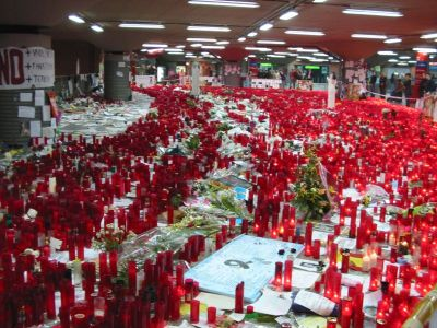 Candles and flowers cover the floor of the Atocha Railway Station in Madrid following the 2004 bombing. (Wikimedia-Commons)