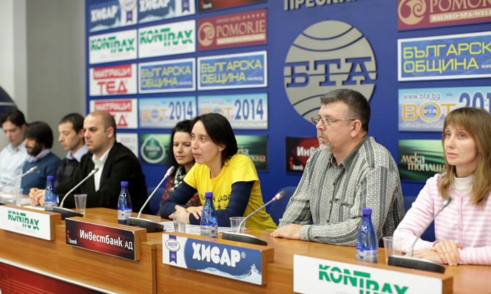 Bulgarian practitioners of Falun Gong speak during a press conference at the Bulgarian Telegraph Agency Pressclub in Sofia, Bulgaria, on Dec. 18, 2014. They revealed facts about their illegal detention in Serbia and shared that after being held for three days in a Serbian arrest, they feel that the persecution ongoing in China is not as far away as they thought. (NTD Television)