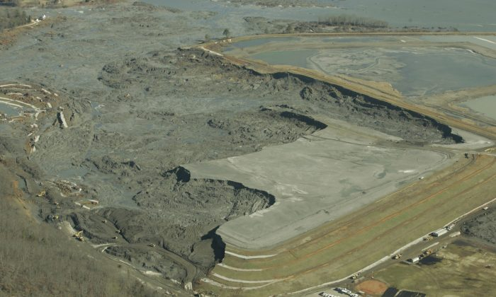 F ILE - In this Monday, Dec. 29, 2008 file image provided by Greenpeace, coal ash slurry left behind in a containment pond near the Tennessee Valley Authority's Kingston Fossil Plant is shown  in Harriman, Tenn., after the dyke at left broke Dec. 22, 2008. The Obama administration is under court order to unveil the rule Friday, Dec. 19, 2014 ending a six-year effort that began after the massive spill at the Tennessee power plant in 2008. Since then, the Environmental Protection Agency has documented coal ash waste sites tainting hundreds of waterways and underground aquifers in numerous states with heavy metals and other toxic contaminants. (AP Photo/Greeenpeace, Wade Payne)