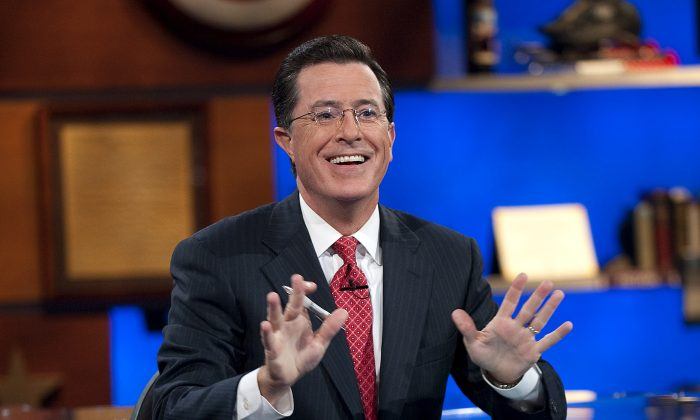 """This Sept. 8, 2010 publicity photo released by Comedy Central shows host Stephen Colbert on """"The Colbert Report,"""" in New York. (AP Photo/Comedy Central, Scott Gries)"""