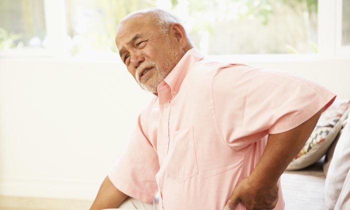 When something minor triggers back pain, it can be tempting to stay still and wait for it to pass, but movement is often the best medicine. (/Monkey Business/Thinkstock)