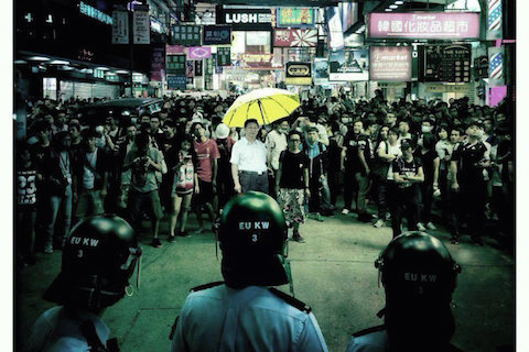 """Uncle Xi"" leads a Mong Kok protester mob against police officers the only way he knows how."