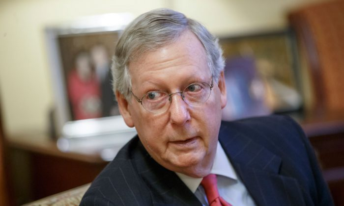 """Incoming Senate Majority Leader Mitch McConnell (R-Ky.), during an interview with The Associated Press at the Capitol in Washington, Wednesday, Dec. 17, 2014. """"How many times did we have the point of the week?"""" Senate Minority Leader Mitch McConnell (R-Ky.) said about Democratic tactics in an interview with AP last week. """"It was designed to make us walk the plank. It had nothing to do with getting a legislative outcome."""" (AP Photo/J. Scott Applewhite)"""