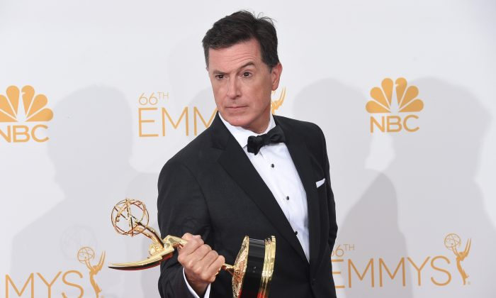 Writer/Producer/Host Stephen Colbert, winner of the for Outstanding Variety Series Award for The Colbert Report, poses in the press room during the 66th Annual Primetime Emmy Awards held at Nokia Theatre L.A. Live on Aug. 25, 2014, in Los Angeles, California. (Jason Merritt/Getty Images)