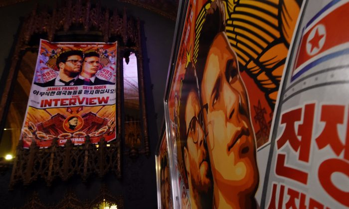 "Movie posters for the premiere of the film ""The Interview"" at The Theatre at Ace Hotel in Los Angeles, Calif., on Dec. 11, 2014. (AFP/Getty Images)"