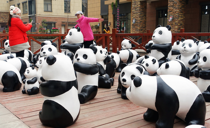 Varied panda sculptures made from wood or bamboo are placed in front of a shopping center on December 20, 2014 in Luoyang, Henan province of China.(ChinaFotoPress/ChinaFotoPress via Getty Images)