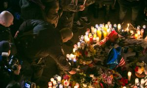 Candlelight Vigil for Slain Cops Honored by Protesters and Police Alike