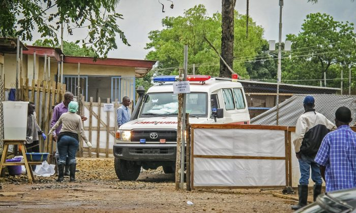 An ambulance leaves the Ebola isolation unit carrying the bodies of Ebola victims that are highly contagious to a burial site, at the Kenema Government Hospital situated in the Eastern Province around 185 miles from the capital city of Freetown in Kenema, Sierra Leone, Aug. 10, 2014. (AP Photo/Michael Duff)
