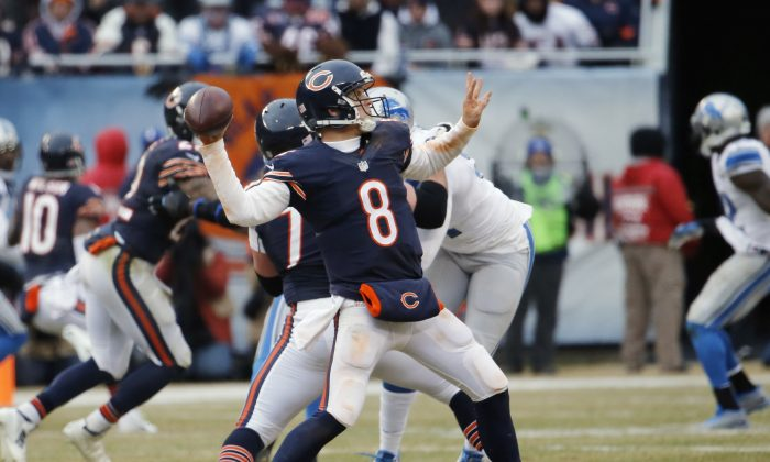 Chicago Bears quarterback Jimmy Clausen (8) throws a touchdown pass to wide receiver Alshon Jeffery in the second half of an NFL football game against the Detroit Lions Sunday, Dec. 21, 2014, in Chicago. (AP Photo/Charles Rex Arbogast)