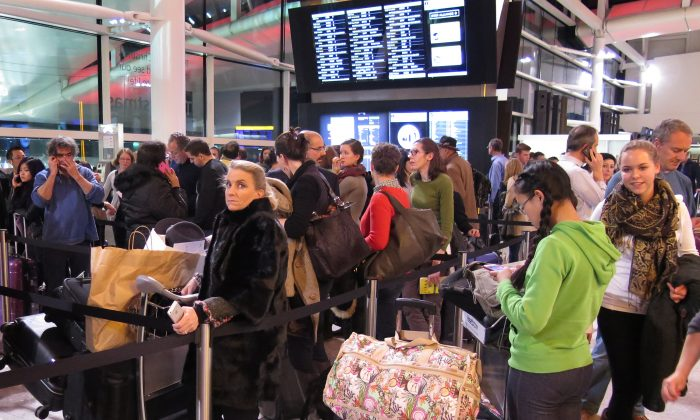Passengers wait for delayed flights at Heathrow Airport in London on Dec. 12, 2014. (Peter Macdiarmid/Getty Images)