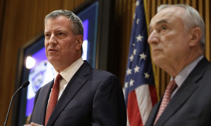 New York City Mayor Bill de Blasio (L) and Police Commissioner Bill Bratton during a news conference at police headquarters in Manhattan, N.Y., on Monday, Dec. 22, 2014. Bratton and de Blasio asked that protesters put on hold their demonstrations against police brutality. (AP Photo/Seth Wenig)