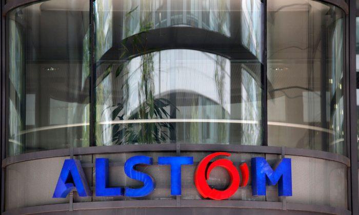 The company logo of Alstom at the headquarters of the leading global maker of high-speed trains, power plants and grids, in Levallois-Perret, outside Paris, France, on April 30, 2014. U.S Justice Department officials on Monday, Dec. 22, 2014, announced French power and transportation company has agreed to pay $772 million in penalties to resolve allegations that it bribed government officials in multiple foreign countries and would plead guilty to violating the Foreign Corrupt Practices Act. (AP Photo/Christophe Ena)