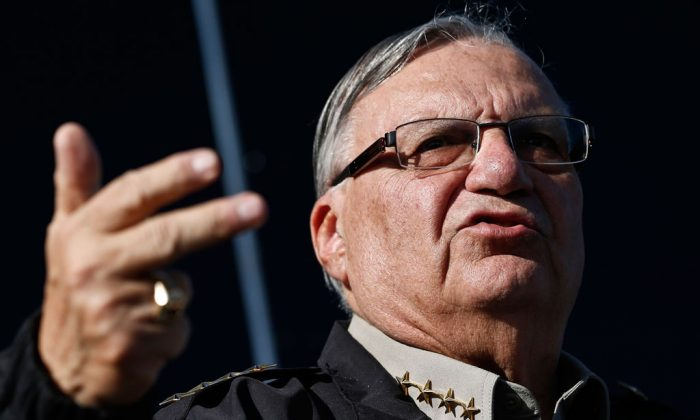 Maricopa County, Ariz., Sheriff Joe Arpaio speaks in Phoenix on Jan. 9, 2013. A gadfly attorney and a county sheriff from Arizona want to halt President Barack Obama's immigration program in the first courtroom battle over the initiative designed to spare nearly 5 million people from deportation. On Monday, lawyer Larry Klayman will try to persuade a judge nominated by Barack Obama that the immigration system, contrary to what the president says, isn't really broken. Klayman says the president has violated the Constitution by doing an end run around Congress and that drastic changes in immigration programs should be stopped. (AP Photo/Ross D. Franklin)