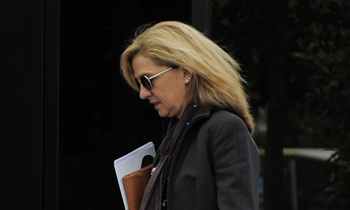Spain's Princess Cristina walks toward her office in Barcelona, Spain, on April 5, 2013. A Spanish judge on Monday Dec. 22, 2014, has ordered Princess Cristina to be tried along with her husband on charges of tax fraud, marking the first time that a member of the country's royal family heads to court since the royalty was restored in 1975. The legal troubles of King Felipe VI's sister during a four-year probe have damaged the Spanish monarchy's image. (AP Photo/Manu Fernandez)