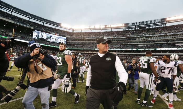 """Black Monday"" is upon us once again in 2014, with a number of NFL teams letting go of their respective head coach go following the end of the regular season. New York Jets head coach Rex Ryan leaves the field after an NFL football game against the New England Patriots Sunday, Dec. 21, 2014, in East Rutherford, N.J. The Patriots won the game 17-16. (AP Photo/Julio Cortez)"