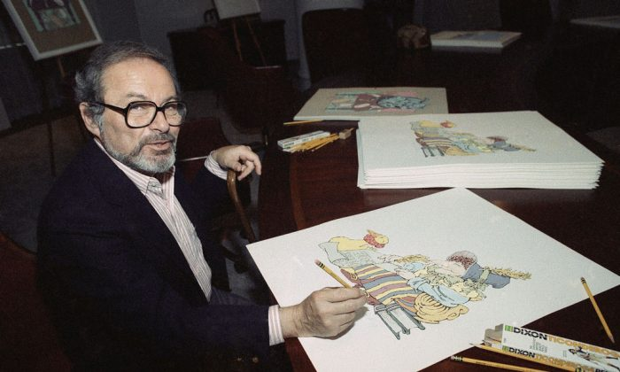 "Artist Maurice Sendak signs his individual prints from the ""The Mother Goose Collection,"" July 26, 1990, in New York. Sendak's death in 2012 sparked debate in the industry over the monetary value of children's literature. (AP Photo/Susan Ragan)"