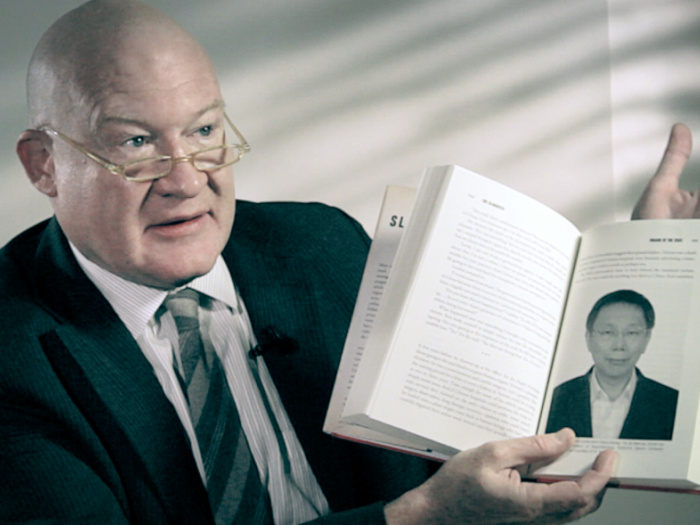 """Ethan Gutmann holds a copy of his book, """"The Slaughter."""" (Courtesy of subject)"""