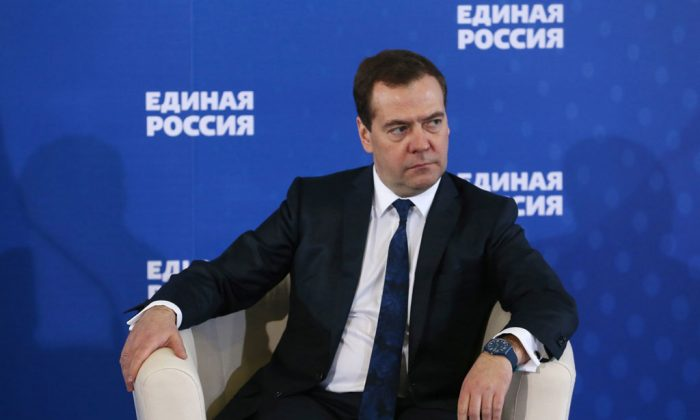 "Russian Prime Minister Dmitry Medvedev listens during a meeting with senior ruling United Russia Party officials in Moscow, Russia on Tuesday, Dec. 23, 2014. Medvedev has warned that the country faces a risk of a ""deep recession"" if the government ditches its spending plans. Speaking at a meeting of his party, Medvedev said Tuesday that the government won't retreat from its strategic aims and social spending. Otherwise, he said Russia could plunge into a ""deep recession."" He also said the Russian economy is in a worse place now than in the 2008 crisis because ""a number of countries are effectively hampering the development of our economy."" (AP Photo/RIA Novosti, Yekaterina Shtukina, Government Press service)"