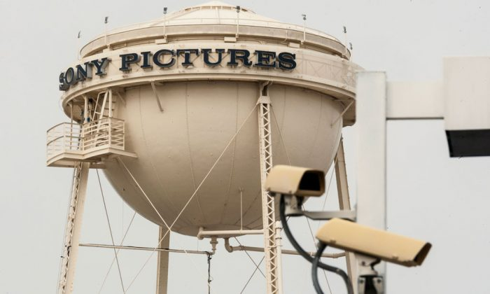 "Security cameras stand across the street on Culver Boulevard from the Sony Pictures Studios' water tank in Culver City, Calif., Thursday, Dec. 18, 2014. Sony abruptly canceled the Dec. 25 release of its comedy, ""The Interview,"" which hackers involved in a cyberterrorism campaign against the studio had demanded partly because it included a scene depicting the assassination of North Korea's leader. Sony cited the hackers' threats of violence at movie theaters that planned to show the movie, although the Homeland Security Department said there was no credible intelligence of active plots. (AP Photo/Damian Dovarganes)"