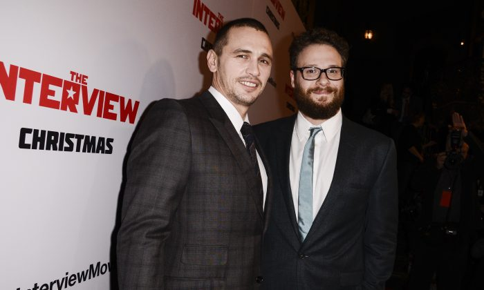 """FILE - In this Dec. 11, 2014 file photo, actors Seth Rogen, right, and James Franco attend the premiere of the Sony Pictures' film """"The Interview"""" in Los Angeles.Sony Pictures Entertainment announced Tuesday a limited theatrical release of """"The Interview"""" beginning Thursday, putting back into the theaters the comedy that prompted an international incident with North Korea and outrage over its cancelled release.  Sony Entertainment CEO Michael Lynton said Tuesday that Seth Rogen's North Korea farce """"will be in a number of theaters on Christmas Day."""" He said Sony also is continuing its efforts to release the film on more platforms and in more theaters.  (Photo by Dan Steinberg/Invision/AP, File)"""