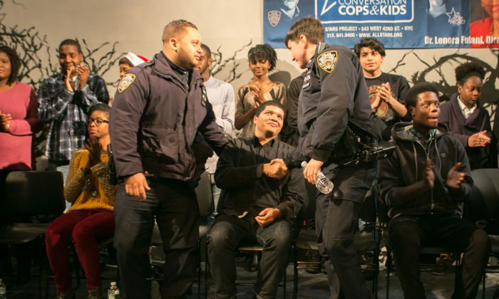Police officers and young teens at a workshop calling for better police-community relations, at the Castillo Theatre in Midtown Manhattan, N.Y., on Wednesday, Dec. 24, 2014. The workshop is geared toward building positive relationships between them through acting out skits and engaging in discussions. (Benjamin Chasteen/Epoch Times)