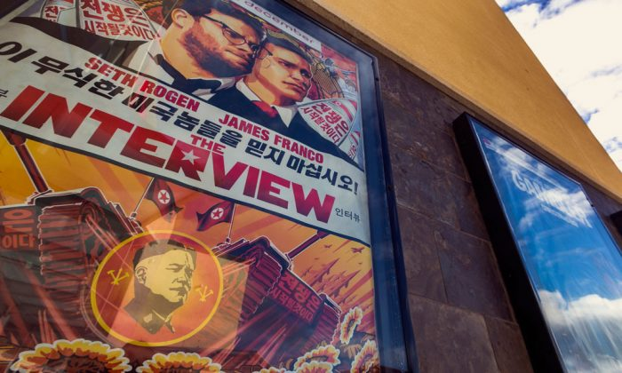 """A movie poster for """"The Interview"""" on display outside the AMC Glendora 12 movie theater, in Glendora, Calif., on Dec. 17, 2014. In an unprecedented move, Sony Pictures broadly released """"The Interview"""" to digital platforms on Wednesday. (AP Photo/Damian Dovarganes)"""
