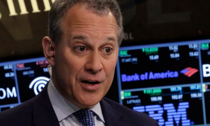 New York Attorney General Eric Schneiderman in Manhattan, N.Y., on Aug. 21, 2014. Schneiderman approved $2.4 million for the legal defense bills of a former state Senate leader acquitted of federal fraud charges. (AP Photo/Richard Drew)