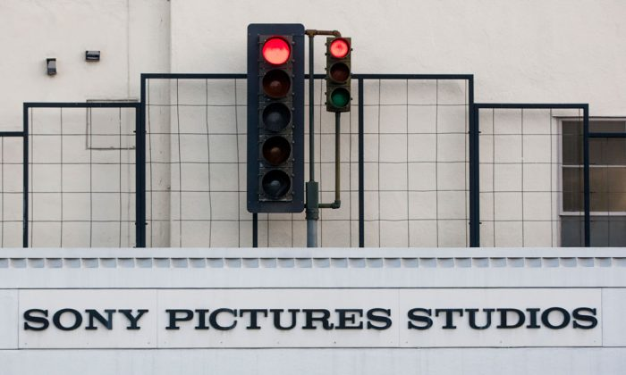 "An exterior view of the Sony Pictures Studios building is seen in Culver City, Calif., on Dec. 19, 2014. It seems everyone has a theory about who really hacked Sony Pictures Entertainment Inc. Despite President Barack Obama's conclusion that North Korea was the culprit, the Internet's newest game of whodunit continues. Top theories include disgruntled Sony insiders, hired hackers, other foreign governments or Internet hooligans. Even some experts are undecided, with questions about why the communist state would steal and leak gigabytes of data, email threats to some Sony employees and their families then threaten moviegoers who planned to watch ""The Interview"" on Christmas. (AP Photo/Damian Dovarganes)"