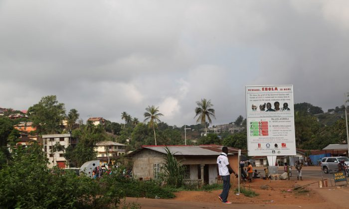 "Sign outside Freetown, capital of Sierra Leone: 'Beware Ebola is Real""."