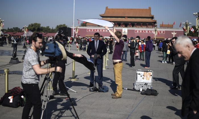 Foreign journalists work in Tiananmen Square in Beijing, China in this file photo. (Fred Dufour/AFP/Getty Images)