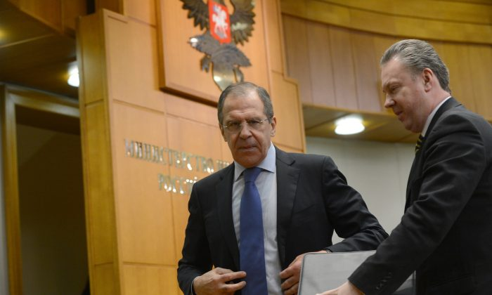 Russian Foreign Minister Sergei Lavrov (L) speaks with Foreign Ministry spokesman Alexander Lukashevich (R) after holding his traditional start-of-year press conference in Moscow, on Jan. 23, 2013, with attention focused on Russia's position on the raging conflict in Syria. (Kirill Kudryavtsev/AFP/Getty Images)