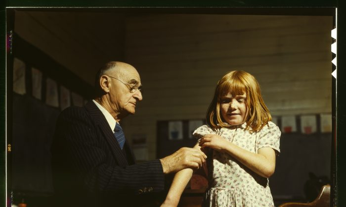 Dr. Schreiber giving a typhoid inoculation at a rural school, San Augustine County, Texas. (Library of Congress)