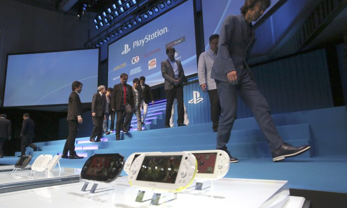 "Lizard Squad has said that the ""attacks on"" the PlayStation Network and Xbox Live ""have stopped."" In this Sept. 1, 2014 photo, Sony Computer Entertainment Japan Asia staff and special guests from computer game companies walk out the stage after a group photo session at  SCEJA press conference on the PlayStation 4 home console in Tokyo. Sony's iconic gadgetry and the star appeal of Hollywood may have appeared to be a perfect match when the electronics giant bought Columbia Pictures in 1989. A quarter century later, it's apparent that Sony Corp. has not attained the magic synergy it was hoping for. The stolid silence of Sony's Tokyo headquarters over the hoopla surrounding ""The Interview"" underscores the longstanding divide between the Japanese parent company and its U.S.-led and -run motion pictures subsidiary, successor to Columbia Pictures. (AP Photo/Eugene Hoshiko)"