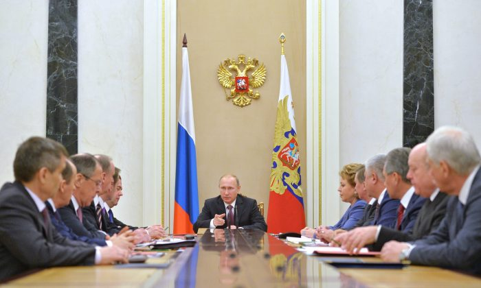 Russian President Vladimir Putin, center, heads the Security Council in Moscow's Kremlin, Russia on Friday, Dec. 26, 2014. (AP Photo/RIA Novosti, Alexei Druzhinin, Presidential Press Service)