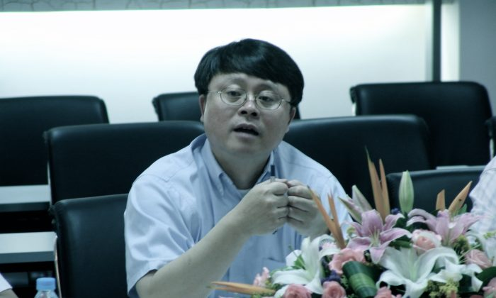 "Jiang Mianheng, former president of the Shanghai branch of the prestigious Chinese Academy of Sciences, speaks at a conference in  July 16, 2005.  Jiang recently stepped down from the post, the official explanation being ""age reasons."" (Chinese Academy of Sciences)"