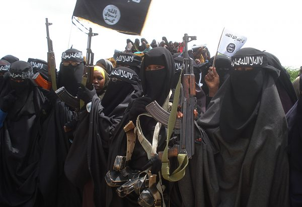 Somali women carry weapons during a demonstration organized by the islamist al-Shabab group in Suqa Holaha neighborhood of Mogadishu, on July 5, 2010. (Abdurashid Abikar/AFP/Getty Images)