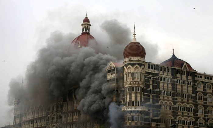 Smoke and flames billow out from The Taj Mahal hotel in Mumbai on Nov. 29, 2008. (Sajjad Hussain/AFP/Getty Images)