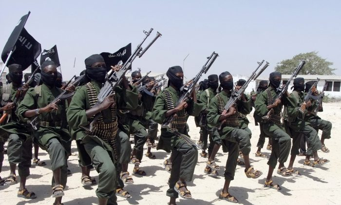 Hundreds of newly trained al-Shabab fighters perform military exercises in the Lafofe area, about 10 miles south of Mogadishu, in Somalia, on Feb. 17, 2011. (AP Photo/Farah Abdi Warsameh)