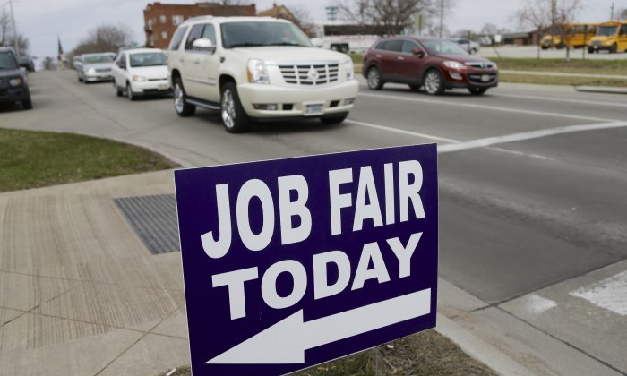 A sign to a job fair on the campus of Kaplan University in Lincoln, Neb., on April 10, 2014. (AP Photo/Nati Harnik)