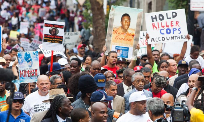 "A march on Staten Island Aug. 23 seeking justice for the death of Eric Garner, dubbed ""We Will Not Go Back."" (Petr Svab/Epoch Times)"