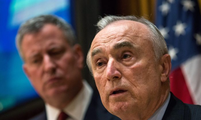 NYPD Commissioner Bill Bratton (R) and NYC Mayor Bill de Blasio speak at a press conference regarding two police officers who were killed on Saturday on Dec. 22, 2014, in New York City. (Andrew Burton/Getty Images)