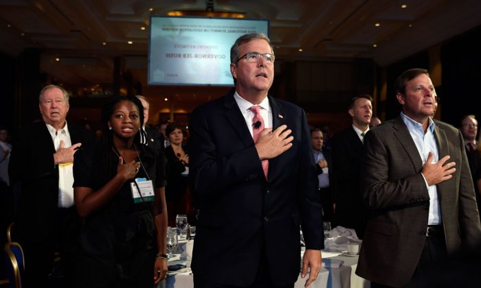 Former Florida Gov. Jeb Bush (C) recites the Pledge of Allegiance before giving the keynote address at the National Summit on Education Reform in Washington on Nov. 20, 2014. Denisha Merriweather (2L), who benefited from the Florida tax credit for education, introduced Bush. The faces of the Republican Party's most ambitious members are changing. Long criticized as the party of old, white, men, the GOP's next class of presidential contenders may include two Hispanic senators, an Indian-American governor, a female business leader and an African-American neurosurgeon. Among perhaps a dozen GOP White House hopefuls, all but a few are in their 40s and 50s. One of the oldest white men, Jeb Bush, is a fluent Spanish speaker whose wife is a native Mexican. Republicans say they're starting the 2016 presidential and congressional elections from a strong place after winning control of Congress a few weeks ago. But Democrats say that's misleading; the midterm electorate was older and whiter than in presidential elections. (AP Photo/Susan Walsh)