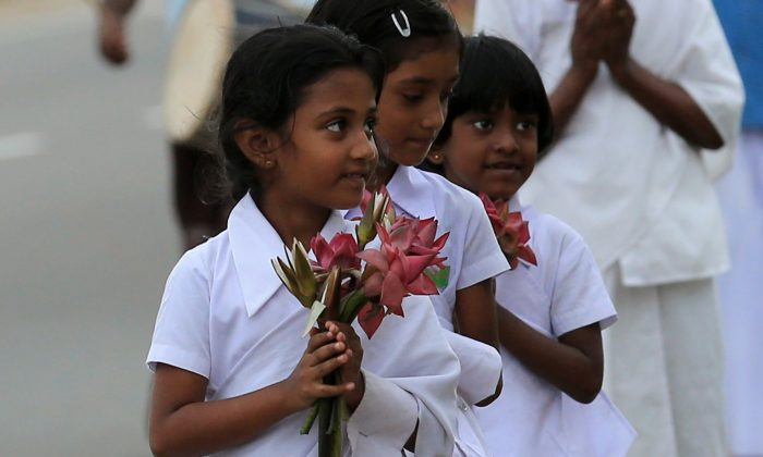 Sri Lankan tsunami survivor children attend a procession as they pray for tsunami victims to commemorate the tenth anniversary of the Boxing Day tsunami in Paralliya, Sri Lanka, on Dec. 26, 2014. (Buddhika Weerasinghe/Getty Images)