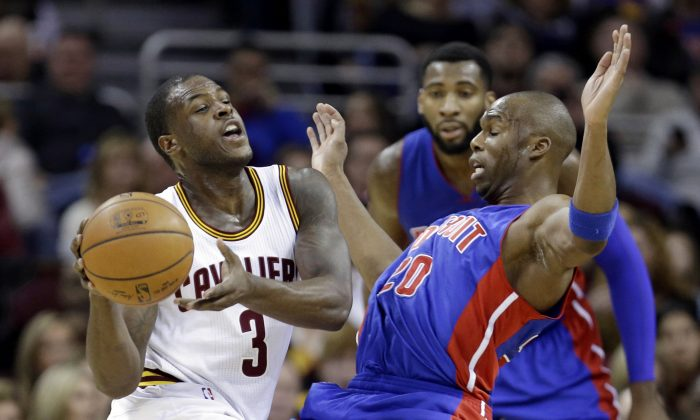 Detroit Pistons' Jodie Meeks, right, fouls Cleveland Cavaliers' Dion Waiters (3) during the second  quarter of an NBA basketball game Sunday, Dec. 28, 2014, in Cleveland. (AP Photo/Tony Dejak)