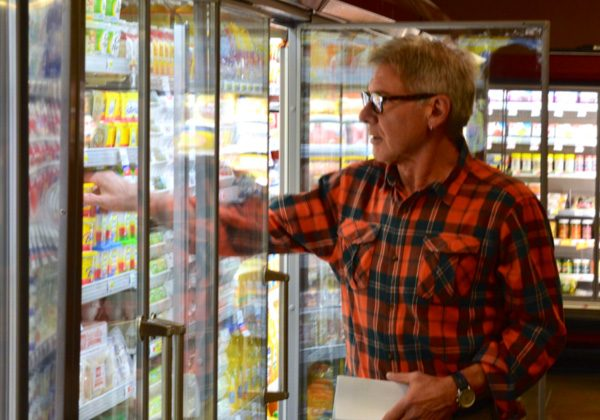 """Actor/Conservationist Harrison Ford doing a bit of field research in a local supermarket. (Scene taken from the Showtime Emmy Award wining climate change series """"Years of Living Dangerously"""". Photograph courtesy of Jeff Horowitz"""