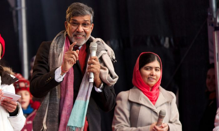 The Nobel Peace Prize 2014 Laureates Kailash Satyarthi (L) and Malala Yousafzai attend the Save The Children's Peace Prize Festival on Dec. 10, 2014 in Oslo, Norway. (Ragnar Singsaas/Getty Images)